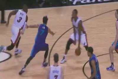 Chris Bosh throws a perfect football snap to assist Dwyane Wade