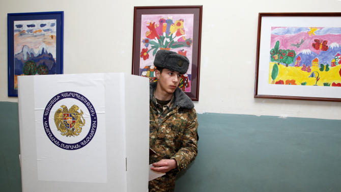 An Armenian soldier takes part in presidential elections in Yerevan, Armenia Monday, Feb. 18, 2013. Incumbent Serge Sarkisian is widely expected to cruise through Monday's voting easily, likely getting the 50 percent plus one vote tally necessary to avoid a second round. Six other candidates are on the ballot. (AP Photo/PanARMENIAN Photo, Varo Rafayelyan)