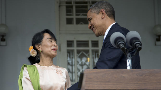 U.S. President Barack Obama and Myanmar opposition leader Aung San Suu Kyi shake hands after speaking to the media at her residence in Yangon, Myanmar, Monday, Nov. 19, 2012. Obama who touched down Monday morning, becoming the first U.S. president to visit the Asian nation also known as Burma, said his historic visit to Myanmar marks the next step in a new chapter between the two countries. (AP Photo/Carolyn Kaster)