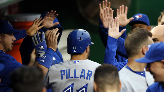 Toronto Blue Jays' Kevin Pillar (11) celebrates his solo home run during the second inning of the second baseball game of a doubleheader against the Washington Nationals at Nationals Park, Tuesday, June 2, 2015, in Washington. (AP Photo/Alex Brandon)