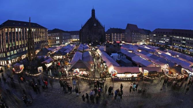 General view shows people visiting opening day of Germany's oldest Christkindlesmarkt in Nuremberg