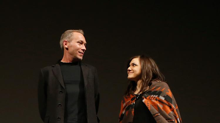 "Producer Michael Costigan, left, and composer Emily Wells speak onstage at Fox Searchlight's ""The Stoker"" premiere during Sundance Film Festival on Sunday, Jan. 20, 2012 in Park City, Utah. (Photo by Todd Williamson /Invision for Fox Searchlight/AP Images)"