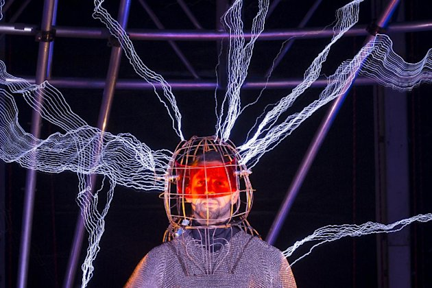 "Magician David Blaine stands inside an apparatus surrounded by a million volts of electric currents streamed by tesla coils during his 72-hour ""Electrified: 1 Million Volts Always On"" stunt on Pier 54"