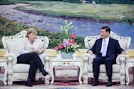 Xi Jinping (right) with German Chancellor Angela Merkel meet in the Great Hall of the People in Beijing on August 30. Xi absence from public view since then has given rise to intense speculation about his health and whereabouts, online and in overseas media