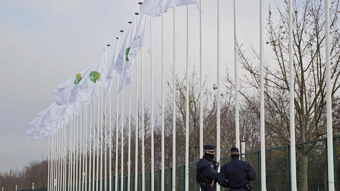 Police officers patrol outside the venue of the United Nations Climate Change Conference in Le Bourget, outside Paris, Friday Nov. 27, 2015. The conference with more than 100 heads of state is scheduled to start on Nov.30. (AP Photo/Michel Euler)