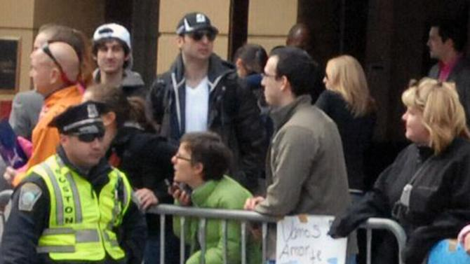 This Monday, April 15, 2013 photo provided by Bob Leonard shows second from left, Tamerlan Tsarnaev, who was dubbed Suspect No. 1 and third from left, Dzhokhar A. Tsarnaev, who was dubbed Suspect No. 2 in the Boston Marathon bombings by law enforcement. This image was taken approximately 10-20 minutes before the blast. (AP Photo/Bob Leonard)