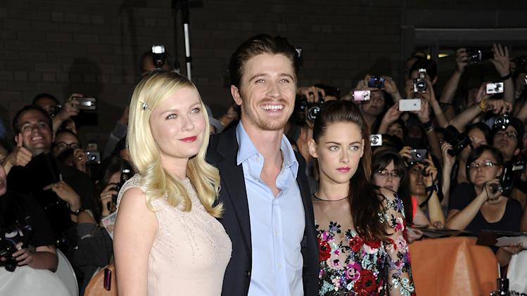 "Cast members Kirsten Dunst, left, Garrett Hedlund and Kristen Stewart are shown before the gala premiere of ""On the Road"" during the Toronto International Film Festival on Thursday Sept. 6, 2012 in Toronto. (Photo by Evan Agostini/Invision/AP)"