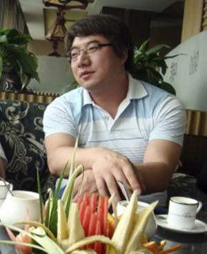 """In this undated photo released by his supporters, Zhai Xiaobing sits at a restaurant in Beijing. Hundreds of Chinese Internet users are rallying around the Beijing blogger who has been detained by police after posting a joke on Twitter about the pivotal Communist Party congress. Zhai's Nov. 5 tweet suggested the next movie in the """"Final Destination"""" horror franchise would be about the Great Hall of the People collapsing on party delegates. A Miyun county police officer told The Associated Press on Wednesday, Nov. 21, 2012, that Zhai was being investigated for """"spreading terrorist information."""" (AP Photo/Supporters of Zhai Xiaobing)"""