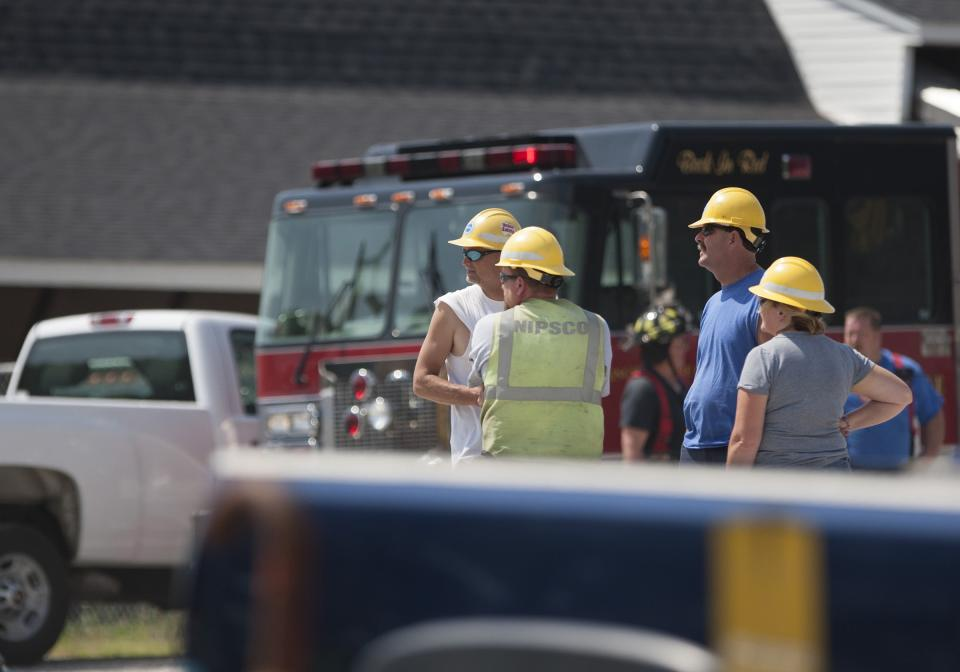 Emergency crews respond to a grain silo explosion that killed an employee on Monday, June 24, 2013, at a fertilizer plant in Union Mills, Ind. (AP Photo/South Bend Tribune, Robert Franklin)