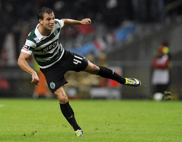 Sporting's Cedric Soares reacts after scoring his team second goal against Sporting Braga during their Portuguese League soccer match at the Municipal Stadium, in Braga, Portugal, Saturday Sept. 26, 2