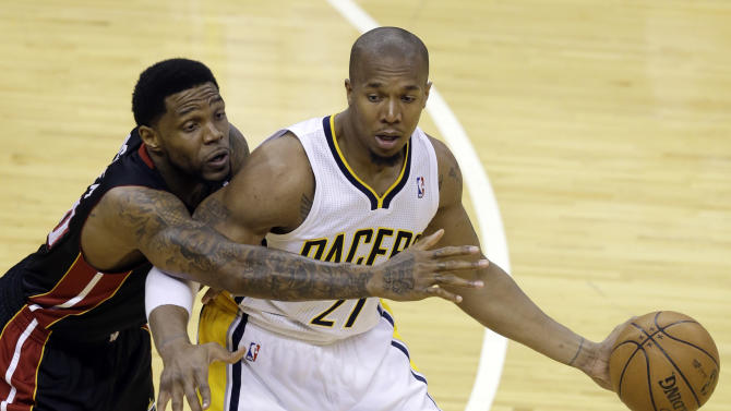 Indiana Pacers' David West (21) is defended by Miami Heat's Udonis Haslem during the first half of Game 3 of the NBA Eastern Conference basketball finals in Indianapolis, Sunday, May 26, 2013. (AP Photo/Michael Conroy)