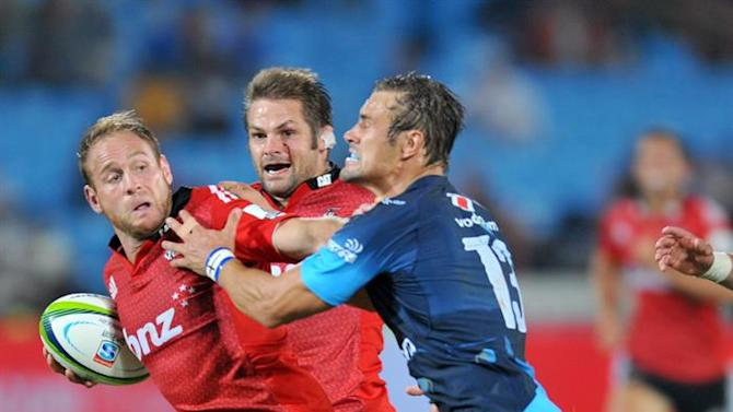 15C2SS. Pretoria (South Africa), 28/03/2015.- Andy Ellis (L) of the Crusaders tackled by JJ Engelbrecht of the Bulls during the 2015 Super Rugby match between the Bulls and the Crusaders at the Loftus Versfeld Stadium in Pretoria, South Africa, 28 March 2015. (Irlanda) EFE/EPA/Samuel Shivambu / BackpagePix UK AND IRELAND OUT