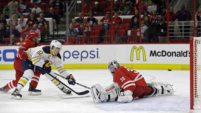 Sabres beat Hurricanes 4-3 in shootout for 1st win