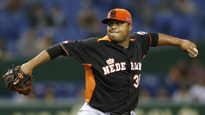 Netherlands' starter Diegomar Markwell delivers a pitch against Cuba in the first inning of their World Baseball Classic second round game in Tokyo, Japan, Friday, March 8, 2013. (AP Photo/Koji Sasahara)
