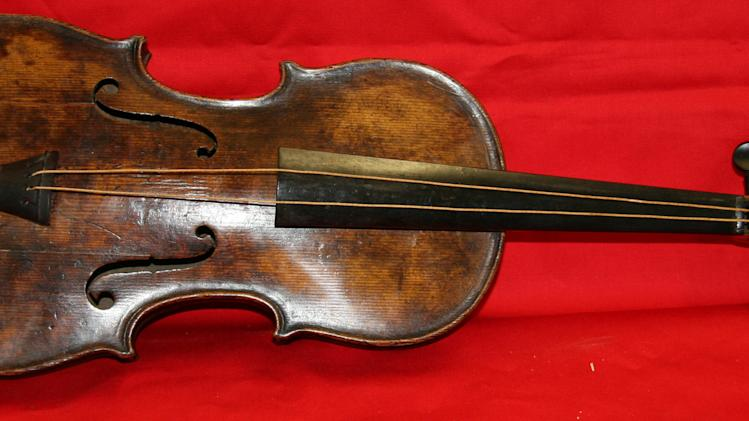 Auction house: We found Titanic violin