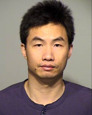 FILE - In this undated file photo released by Milwaukee County Sheriff's Office, is Hua Jun Zhao, 42, a researcher accused of stealing a possible cancer-fighting compound from the Medical College of Wisconsin. Court records show that Zhao was indicted Tuesday, April 9, 2013, on charges of computer fraud and lying to a federal agent. (AP Photo/Milwaukee County Sheriff's Office, File)