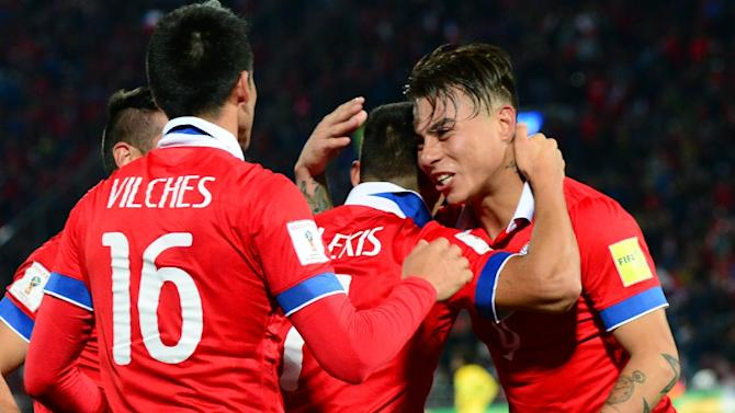 Chile's Eduardo Vargas (R), Alexis Sanchez (C) and Cristian Vilches celebrate at the end of their Russia 2018 FIFA World Cup qualifiers match against Brazil