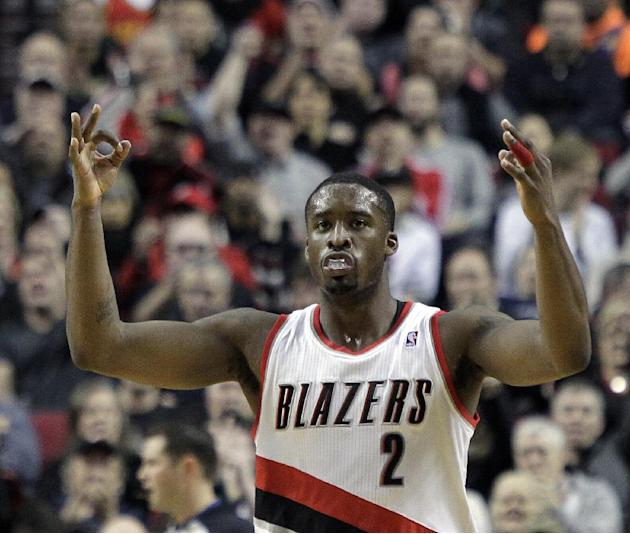 Portland Trail Blazers guard Wesley Matthews signals after sinking a three point shot during the first half of an NBA basketball game against the Oklahoma City Thunder in Portland, Ore., Wednesday, De