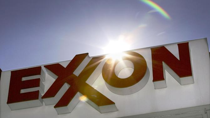 FILE - This Oct. 26, 2006 file photo shows an Exxon logo seen at a Dallas gas station. Exxon has once again surpassed Apple as the world's most valuable company after the iPhone and iPad maker saw its stock price falter, according to reports Friday, Jan. 25, 2013. Apple first surpassed Exxon in the summer of 2011. The two companies traded places through that fall, until Apple surpassed Exxon for good in early 2012. (AP Photo/LM Otero, File)