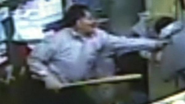 Chicago store owner uses baseball bat to fight off gunman