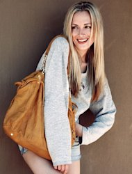 An undated picture of South African model Reeva Steenkamp who was allegedly shot dead on February 14, 2013 by her Olympic sprint star boyfriend Oscar Pistorius. Steenkamp will appear in a pre-recorded celebrity reality TV show in South Africa, two days after her death shocked the nation and the world