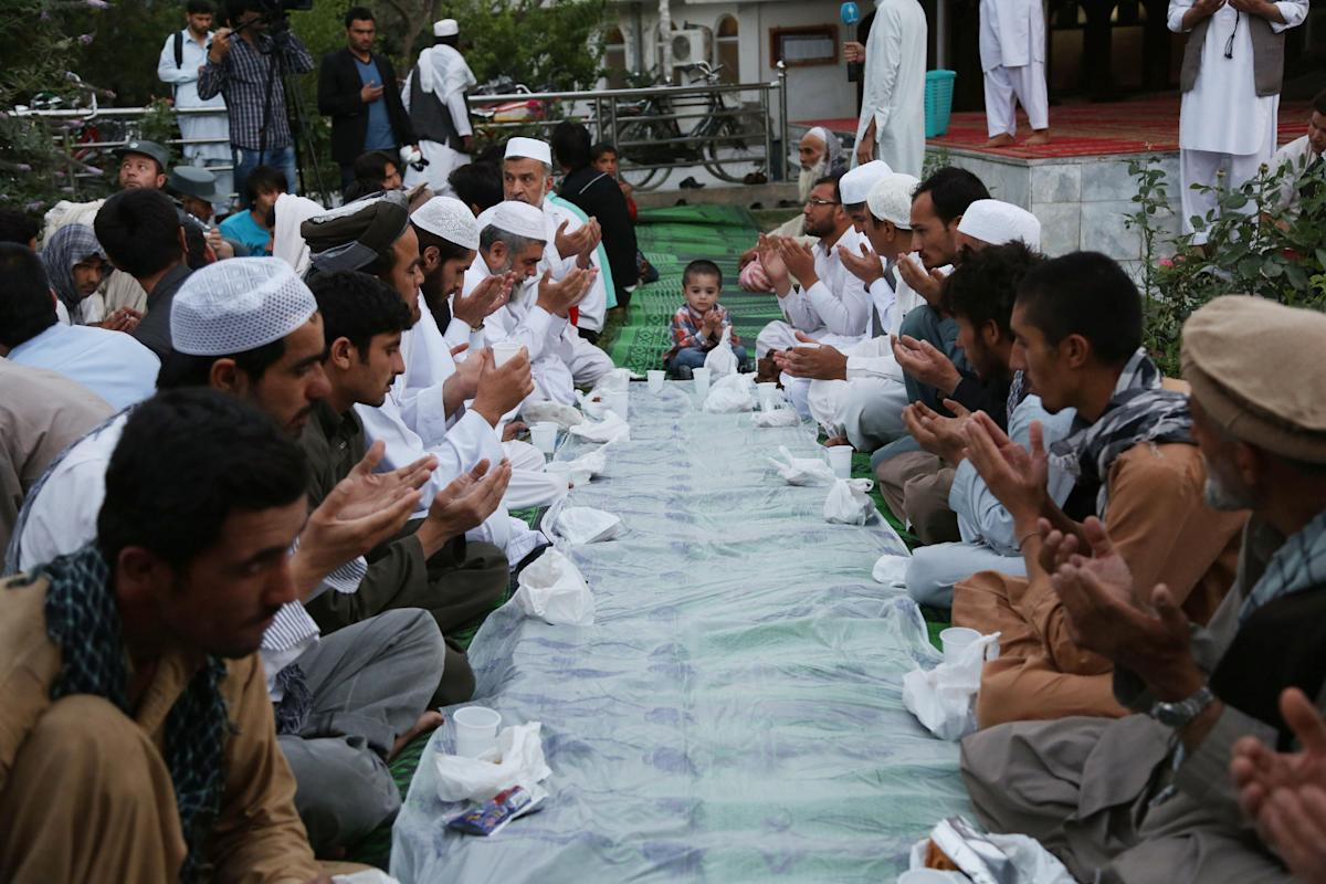 Afghans pray before breaking their fasting during the Muslim holy month of Ramadan in Kabul, Afghanistan, Sunday, June 29, 2014. Muslims throughout the world are celebrating the holy fasting month of Ramadan, refraining from eating, drinking, and smoking from dawn to dusk. (AP Photo/Rahmat Gul)