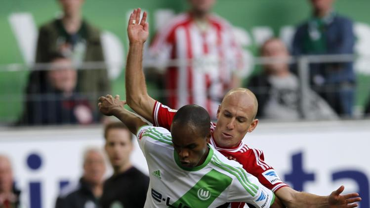 Wolfsburg's Naldo is tackeld by Bayern Munich's Arjen Robben during their German first division Bundesliga soccer match in Wolfsburg