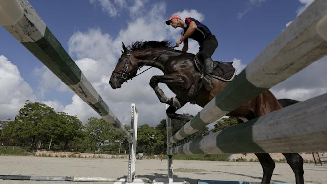 Junior Concepcion, 27, a Cuban jockey, rides a horse during a jumping training session of the Cuba national team in Havana