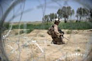 This file photo shows a US Marine conducting a patrol in Garmser, Helmand province, in June. Two US Marines were killed in an attack on a heavily fortified airfield in Afghanistan where Prince Harry is deployed