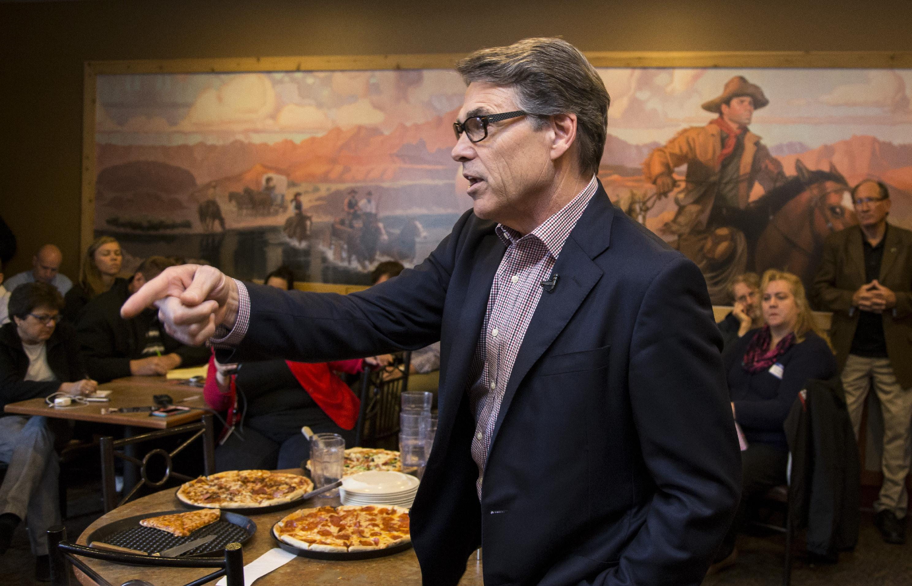 Perry seeks to win over Iowa, a handshake at a time