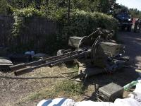 Ukrainian servicemen guard a checkpoint in Luhansk region