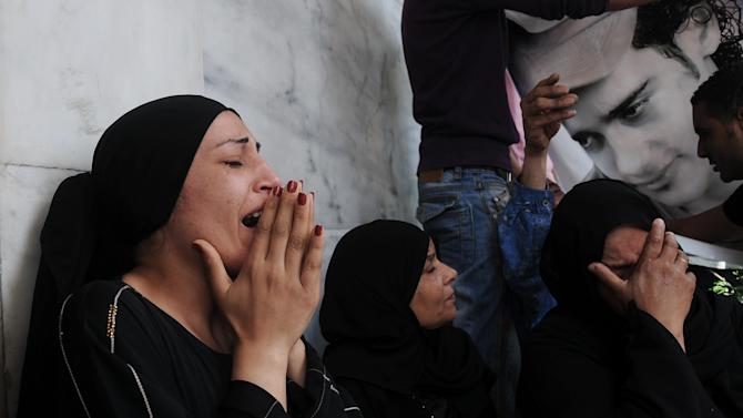 Egyptian women mourn over the death of victims of clashes outside the Defense Ministry in Cairo, Egypt, Wednesday, May 2, 2012. Suspected supporters of Egypt's military rulers attacked predominantly Islamist anti-government protesters outside the Defense Ministry in Cairo Wednesday, setting off clashes that left more than ten people dead as political tensions rise three weeks before crucial presidential elections. (AP Photo/Mohammed Asad)