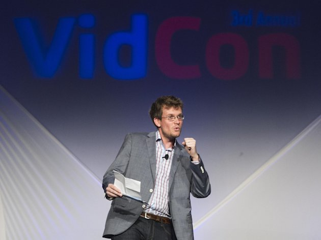 In this Thursday, June 28, 2012 photo, VidCon cofounder, author John Green delivers the opening address for the third annual VidCon conference and community gathering for online video in Anaheim, Calif. More than 6,000 people are expected to attend VidCon at the Anaheim Convention Center this weekend. (AP Photo/Damian Dovarganes)