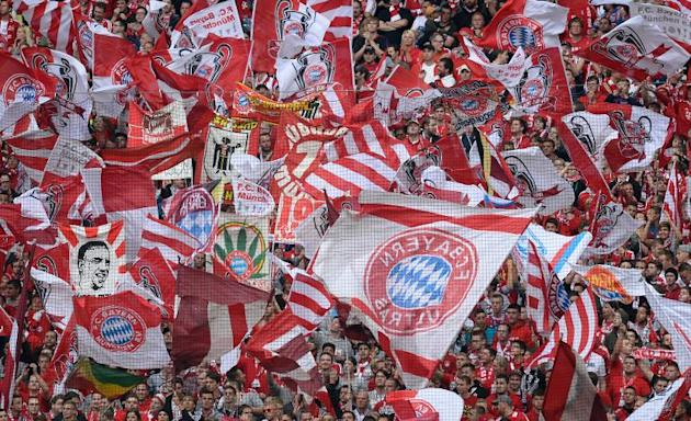 Bayern Munich fans wave the club's flags in Munich, southern Germany, on September 14, 2013