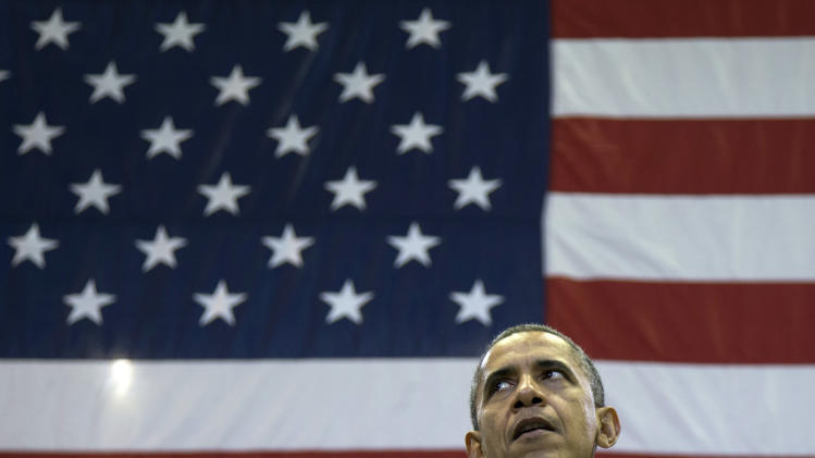 President Barack Obama pauses during a speech at a campaign event at the Fifth Third Arena on the University of Cincinnati campus, Sunday, Nov. 4, 2012, in Cincinnati.  (AP Photo/Carolyn Kaster)