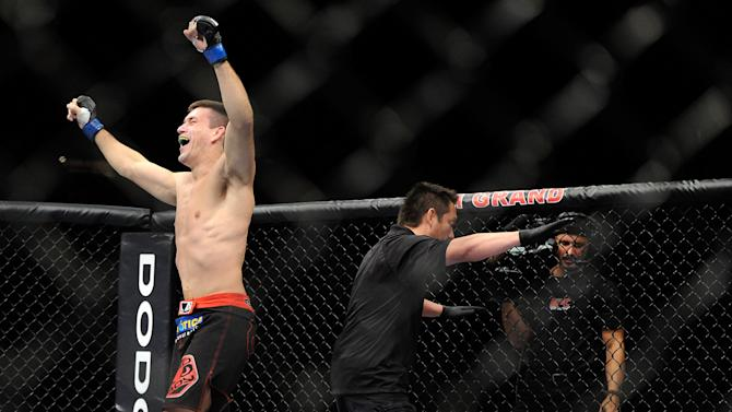 Demian Maia, left, celebrates after knocking down Dong Hyun Kim during the first round their UFC 148 welterweight fight at the MGM Grand Garden Arena, Saturday, July 7, 2012, in Las  Vegas. Maia won the bout by TKO. (AP Photo/David Becker)