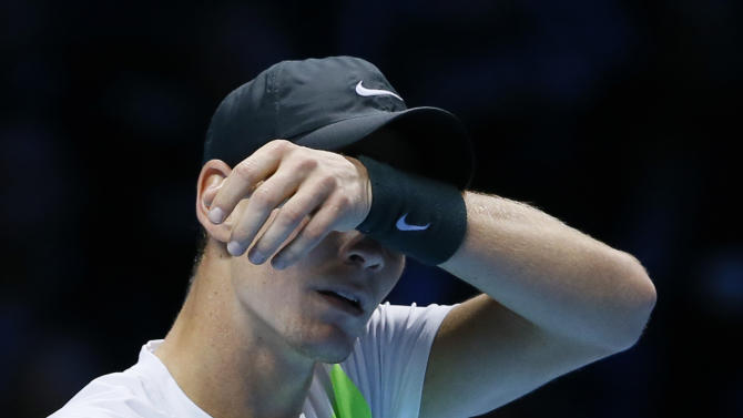 Tomas Berdych of the Czech Republic reacts after playing a return to Novak Djokovic of Serbia during their singles tennis match at the ATP World Tour Finals in London Friday, Nov. 9, 2012. (AP Photo/Kirsty Wigglesworth)