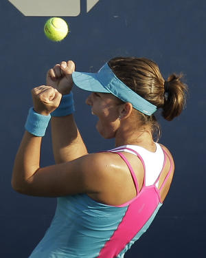 SimonaHalep of Romania reacts after beating Li Na of China during the first round of the U.S. Open tennis tournament in New York, Tuesday, Aug. 30, 2011. (AP Photo/Charlie Riedel)