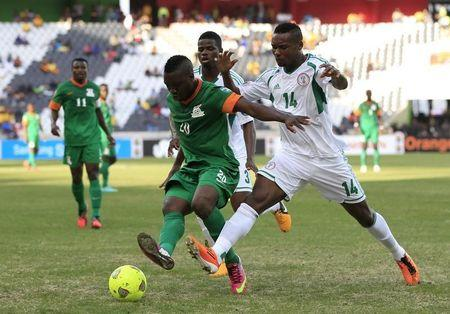 Nigeria's Godfrey Oboabona competes for the ball with Zambia's Emmanuel Mayuka during their AFCON 2013 Group C soccer match in Nelspruit
