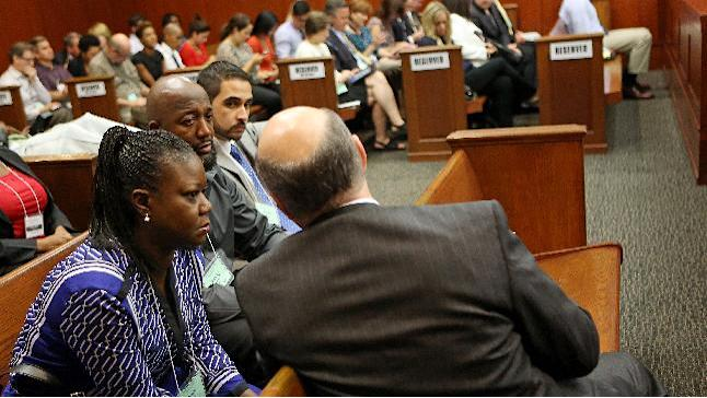 Assistant state attorney Bernie de la Rionda, right front, speaks with Trayvon Martin's parents Sybrina Fulton, left and Tracy Martin, center, at the end of the lunch recess during George Zimmerman's trial in Seminole circuit court in Sanford, Fla. Wednesday, June 26, 2013. Zimmerman has been charged with second-degree murder for the 2012 shooting death of Trayvon Martin.(AP Photo/Orlando Sentinel, Jacob Langston, Pool)