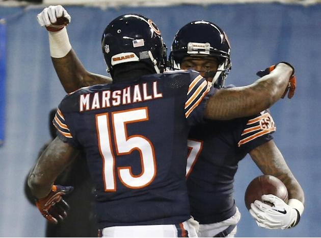 Chicago Bears wide receiver Alshon Jeffery (17) is congratulated by wide receiver Brandon Marshall (15) for his touchdown reception against the Dallas Cowboys during the first half of an NFL football