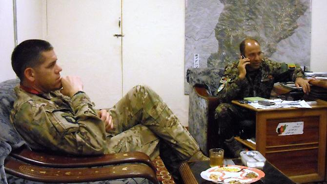 In this photo taken March 22, 2013, U.S. Army security adviser Lt. Col Bryan Laske of the U.S. Army's No Slack Battalion 2/327, 1st Brigade Combat Team, 101st Airborne Division, and Afghan Army Col. Hayatullah, commander of the 2nd Brigade, 201st Corps, right, meet at the Afghan Army's Sarkani Base in the Kunar province of eastern Afghanistan. U.S. commanders trying to hand off war-fighting responsibility by the end of 2014 are encouraged by the uneven yet steady progress of fledgling Afghan security forces. (AP Photo/Kim Dozier)