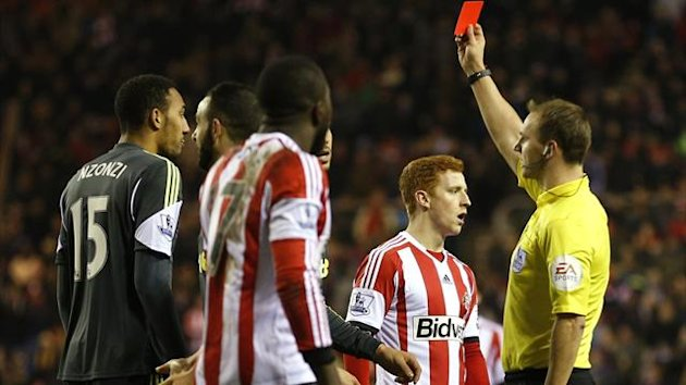Stoke City's Steven N'Zonzi (L) is shown a red.