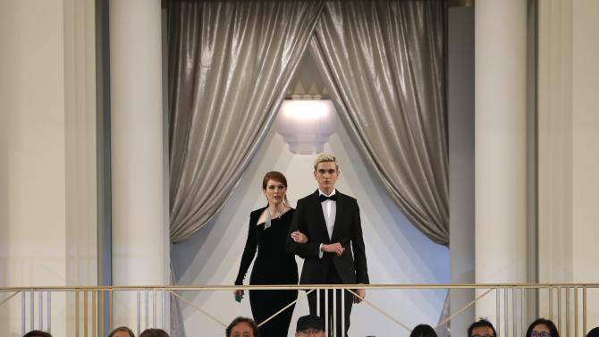 Actress Julianne Moore presents a creation by German designer Karl Lagerfeld as part of his Haute Couture Fall Winter 2015/2016 fashion show for French fashion house Chanel at the Grand Palais which is transformed into a casino in Paris