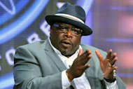"FILE - This Aug. 4, 2013, file photo, shows game show host Cedric ""The Entertainer"" of ""Who Wants To Be A Millionaire"" at the Disney/ABC Television Group's 2013 Summer TCA panel in Beverly Hills, Calif. On Sept. 2, the new season premieres, ushering in Cedric ""The Entertainer"" as host. (Photo by Vince Bucci/Invision/AP, File)"