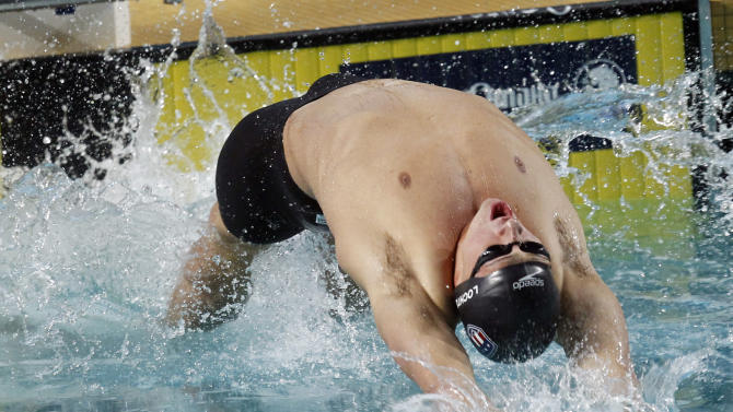 Ryan Lochte competes in the men's 200-meter backstroke during the Duel in the Pool swim meet against Europe at Georgia Tech, Friday, Dec. 16, 2011, in Atlanta. Lochte won the event. (AP Photo/John Bazemore)