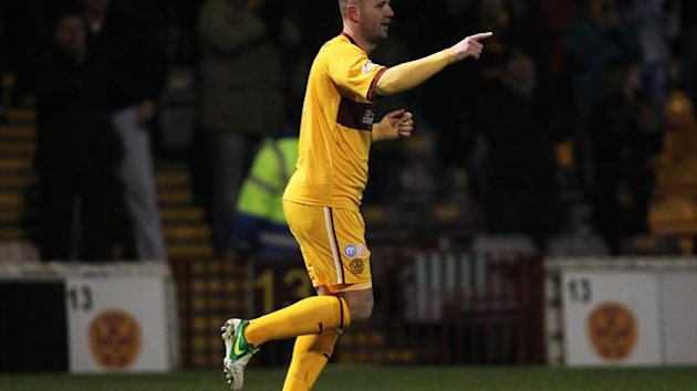 Michael Higdon gave Motherwell an early lead at Tynecastle