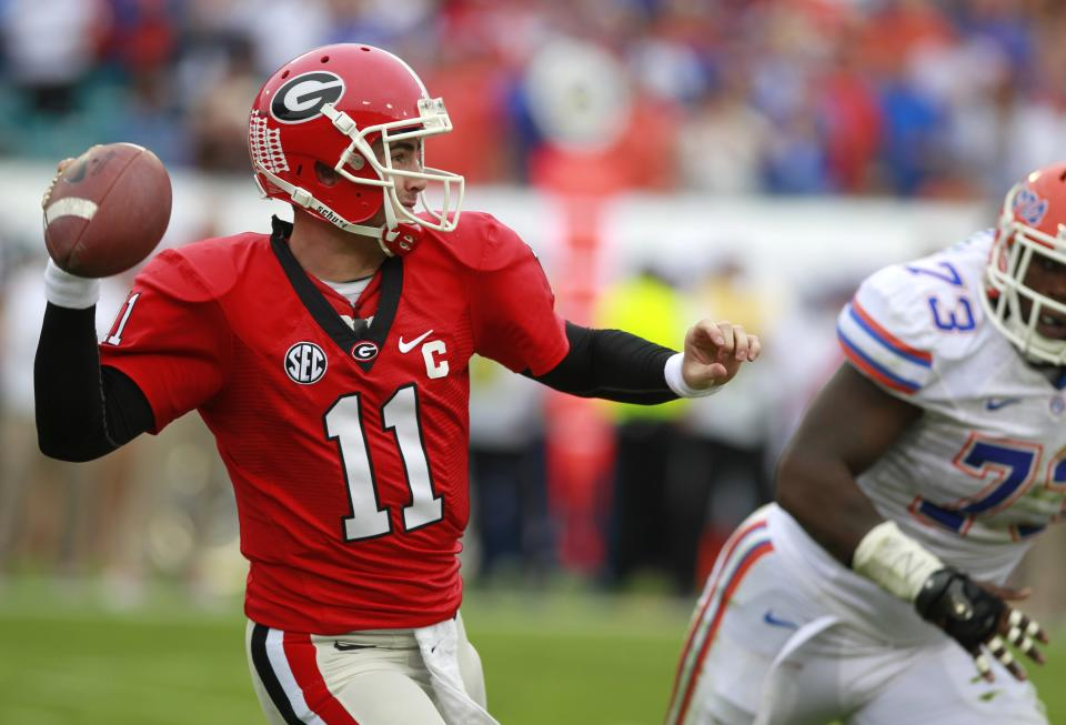 Georgia quarterback Aaron Murray (11) throws a pass as he is pressured by Florida defensive lineman Sharrif Floyd (73) during the first half of an NCAA college football game on Saturday, Oct. 27, 2012, in Jacksonville, Fla. (AP Photo/John Raoux)