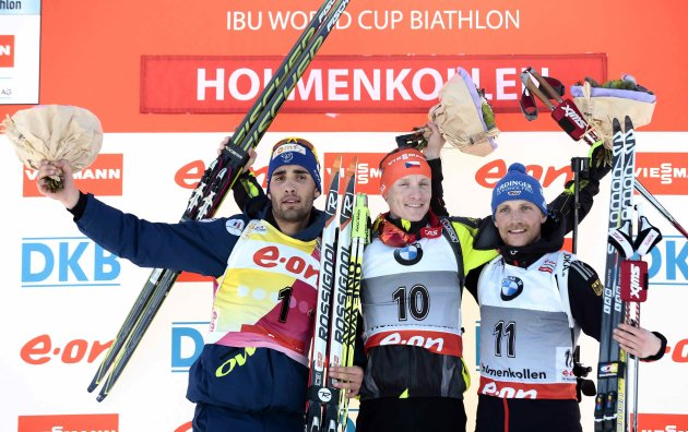 Moravec of the Czech Republic poses on the podium between Fourcade of France and Lesser of Germany after the men's 15 km mass start race at the Biathlon World Cup in Oslo