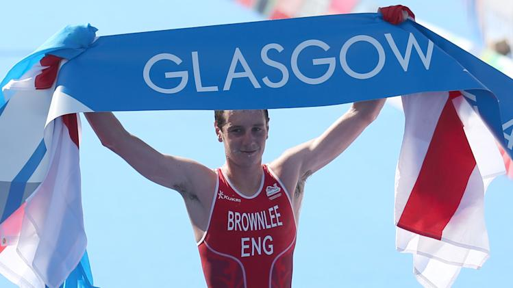 England's Alistair Brownlee celebrates after winning the men's Triathlon race at the Commonwealth Games Glasgow 2014, Strathclyde Country Park, Scotland, Thursday July 24, 2014. The games runs until August 3, with 71 countries and 2 territories taking part